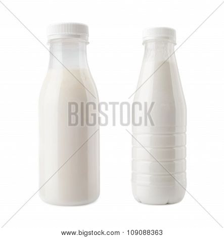 plastic bottles of milk drink close-up isolated