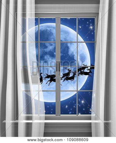 Santa sleigh and reindeer racing past the moon to deliver gifts on Christmas Eve