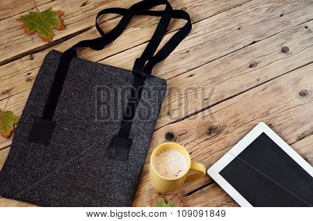 Women's Bag With A Cup Of Latte And Tablet Computer
