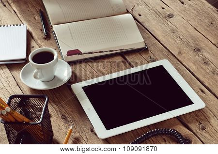 White Tablet Computer With On Office Wooden Table