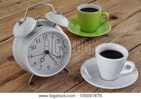 Cups Of Espresso With An Alarm Clock