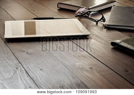 White Tablet Computer With Office Objects On Office Wooden Table