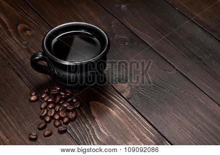 Black Cup Of Coffee With Grains Coffee