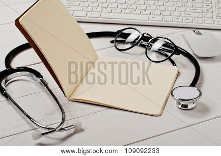 Open Notebook With Blank Pages With A Stethoscope