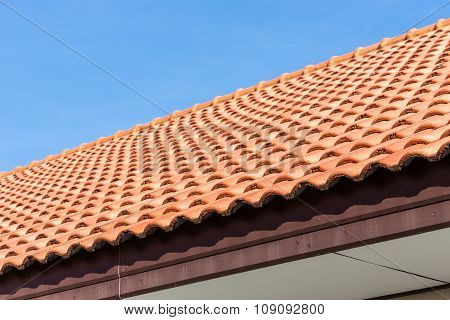 Red Tiles Roof And Blue Sky Background