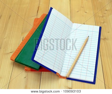 Empty Notepad On Wooden Surface And Pencil