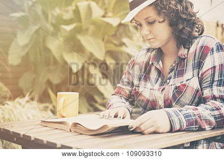 A Teenager Reading In The Garden