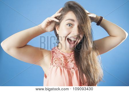 A Young Girl Holding His Head And Screaming..