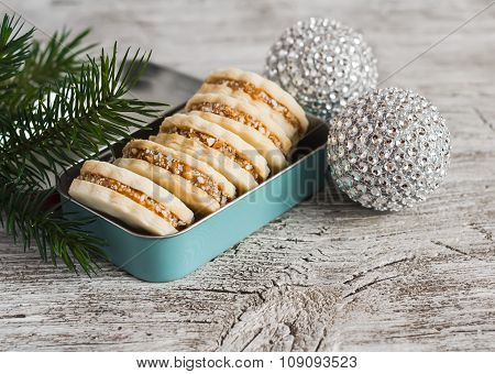 Cookies With Caramel Cream And Walnuts In A Vintage Metal Box, Christmas Decoration  On Bright Woode