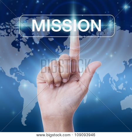 hand pressing mission word button. business concept