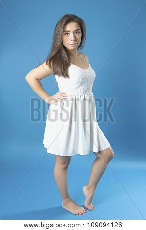 Young Girl In A White Dress With Long Hair..