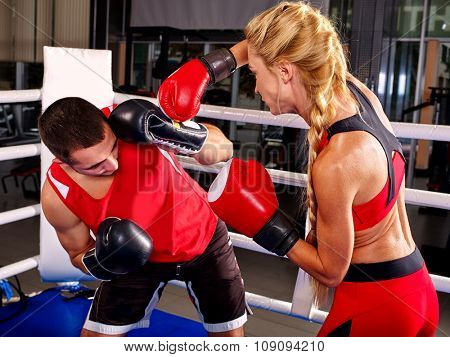Couple Man and  Woman Wearing Gloves Boxing in Ring. Preparing for competition.
