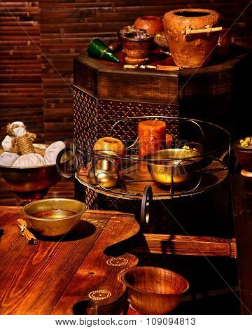Luxury ayurvedic spa massage with candles still life.