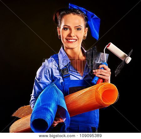 Happy smiling woman builder with construction tools on black background .
