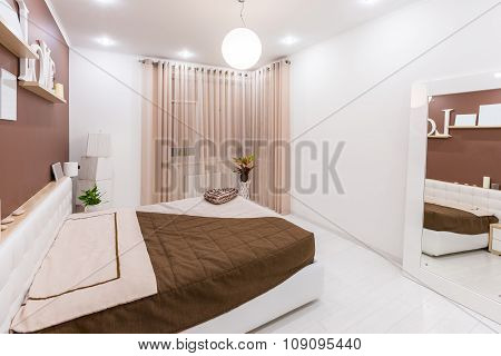 Modern minimalism style bedroom interior in light warm tones