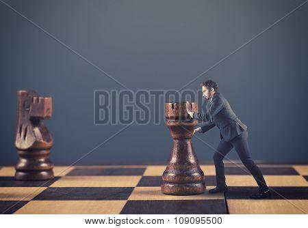 Man Pushing Chess Pieces