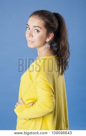 Girl In A Yellow Jacket Half-turned..