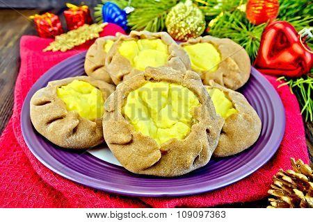 Carols With Potatoes On Napkin With Christmas Toys