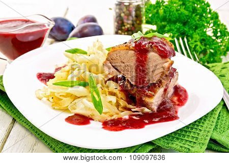 Duck Breast Whole With Plum Sauce And Cabbage In Plate On Napkin