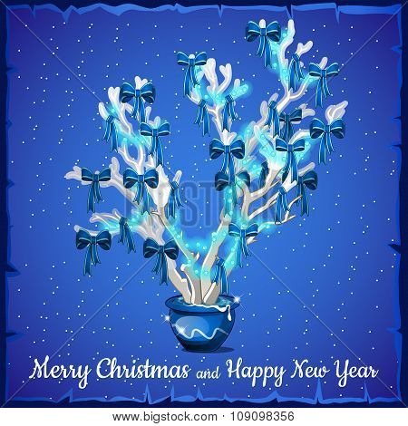 Christmas card decorated with silver tree on a blue background