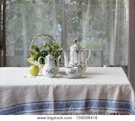 Tea In A Cup, A Green Apple And A Bouquet