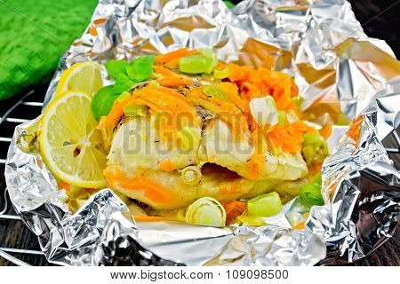 Pike With Carrots And Leeks In Foil On Board