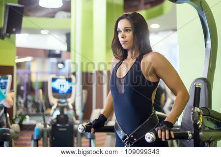 Athlete woman workout out arms on dips horizontal parallel bars Exercise training triceps and biceps