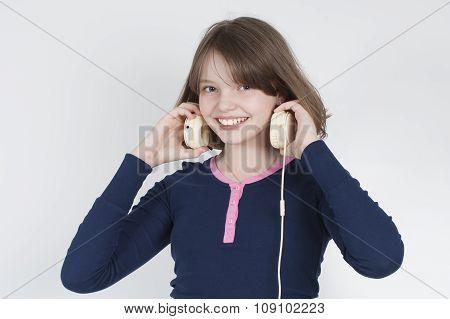 Girl Wears Headphones..