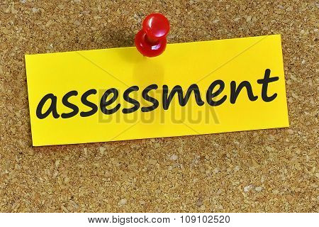 Assessment Word On Yellow Notepaper With Cork Background