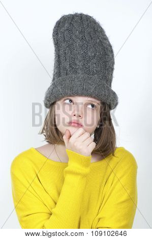 Thoughtful Girl In A Funny Hat.