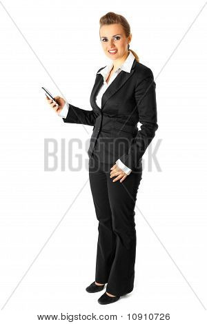 Full length portrait of smiling modern business woman dialing phone number
