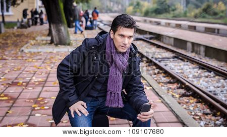 Elegant Businessman Waiting For The Train