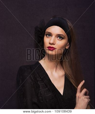 Portrait Of A Beautiful Woman In Vintage Style