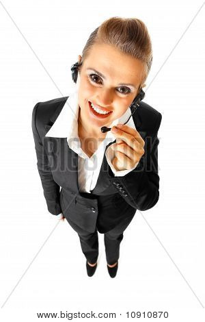 Full length portrait of smiling telephone operator with headset