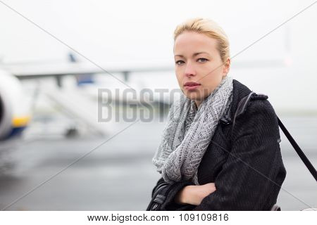 Woman boarding airplain.