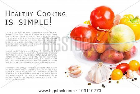 Fresh Vegetables In A Glass Pot Isolated On White Background. With Place For A Sample Text