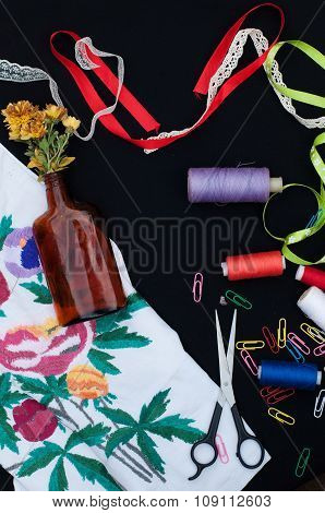 Scissors, bobbins with thread. Sewing kit.