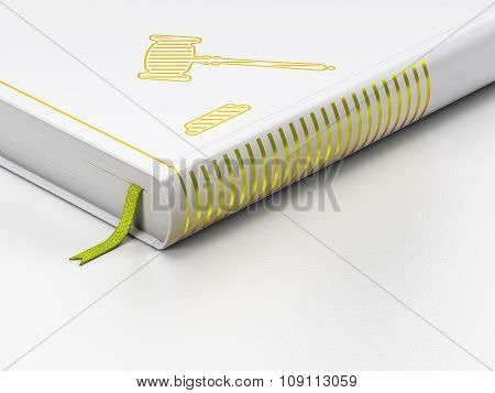 Law concept: closed book, Gavel on white background