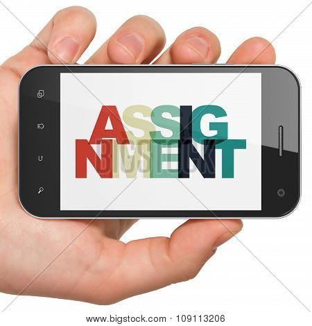 Law concept: Hand Holding Smartphone with Assignment on  display