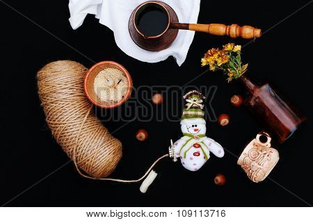 Christmas card with coffee and snowman. Cup of hot drink. Holiday Christmas concept. Nuts, a bouquet