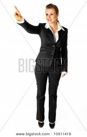 Full length portrait of smiling modern business woman touching abstract screen