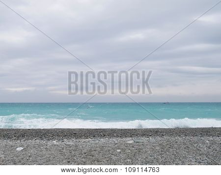 Sand gravel beach with wave of sea water