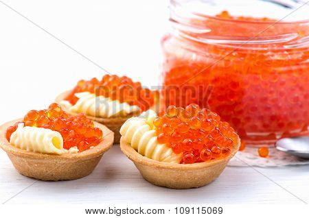 Tartlets with red caviar close up. Gourmet food, appetizer