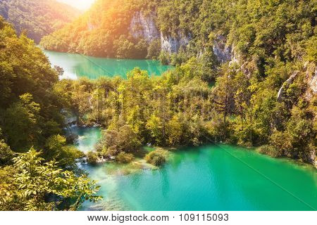 Majestic view on turquoise water and sunny beams in the famous resort Plitvice Lakes National Park. Croatia. Europe. Dramatic scene. Beauty world. Retro and vintage style. Instagram toning effect.