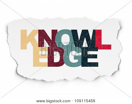 Education concept: Knowledge on Torn Paper background