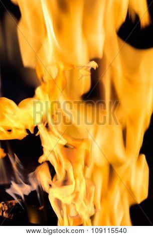 Texture Of Orange Flame On A Dark Background