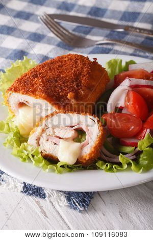 Delicious Sliced Chicken Cordon Bleu And A Salad Close-up. Vertical