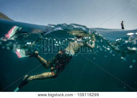 Underwater photographer with big camera