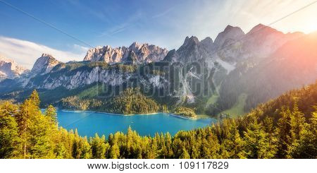 Fantastic azure lake Vorderer Gosausee. Picturesque scene. Salzkammergut is a famous resort area located in the Gosau Valley in Upper Austria. Gosaukamm range and Dachstein glacier. Beauty world.