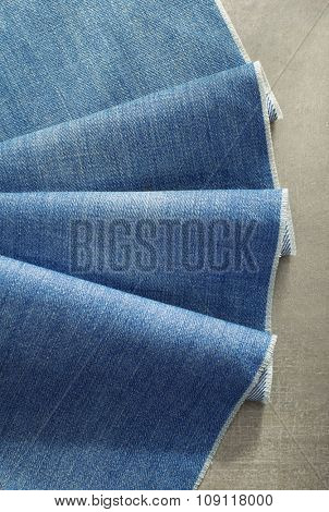 blue jeans texture on wooden background